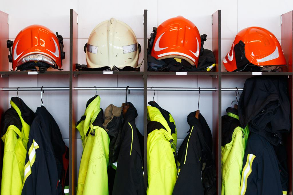 Fireman's helmet and jackets in the locker